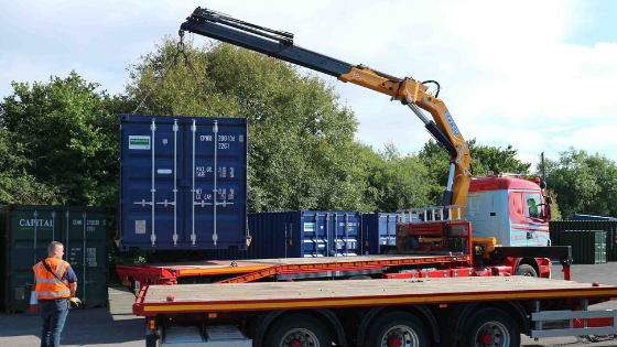 Crane truck loading container